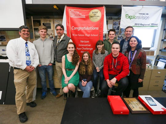 Six students at West Salem High School pose with teachers and a representative with the Verizon Foundation as they are awarded a Best in Nation award on Tuesday, Feb. 2, 2016. The students were presented with the award for their idea to develop a mobile application to help students test career aptitude and connect to local people in their desired industry.