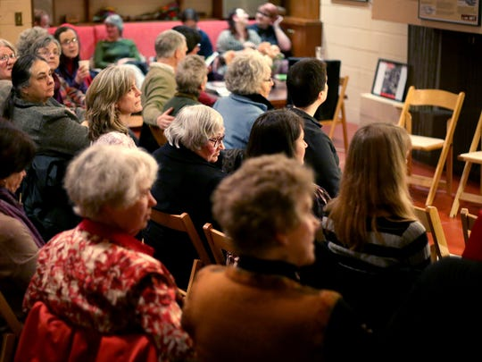 People gather for the kick-off of 2015's Silverton Poetry Festival at the Frank Lloyd Wright Gordon House in Silverton.