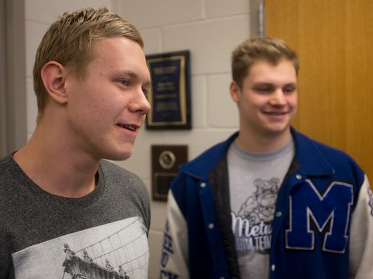 Monroe swimmer Rich Fortels, left, and Metuchen swimmer Michael Spark discuss their GMC medal controversy, Monday, February 8, 2016, at Monroe Township High School in Monroe.