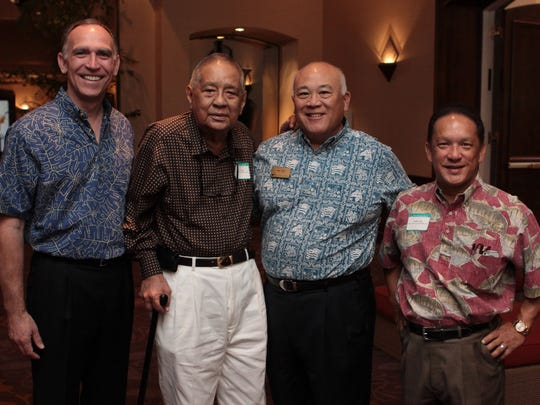 """In this file photo, from left: Robert Harrison, First Hawaiian Bank president and CEO; Pedro """"Pete"""" Ada, Ada's Trust & Investment chairman; Ray Ono, First Hawaiian Bank vice chairman and COO; and Sonny Ada, Ada's Trust & Investment president, pose for a photograph at a customer appreciation party held b the bank at the Hyatt Regency Guam."""