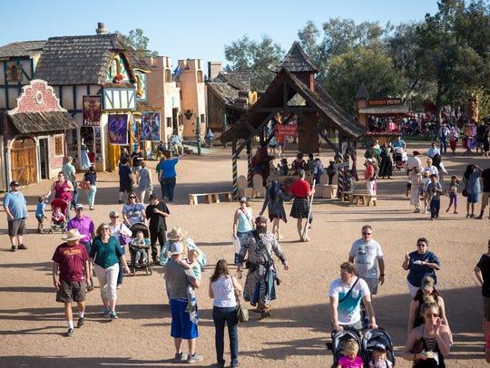 People walk through the Arizona Renaissance Festival