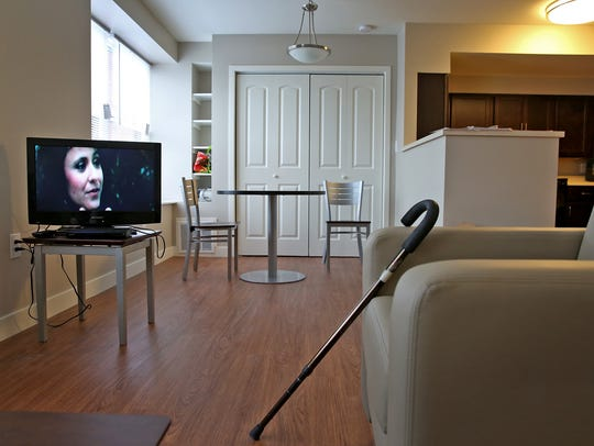 A TV plays in this resident's apartment at Penn Place