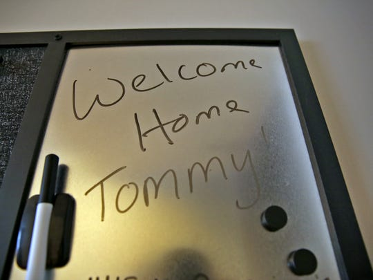 """A message board for appointments and other reminders, as well as a """"Welcome Home"""" note, are in the residents' apartments at Penn Place. The former motel on the Old Northside has been renovated into 38 one-bedroom apartments for the homeless, a health center and social service office."""