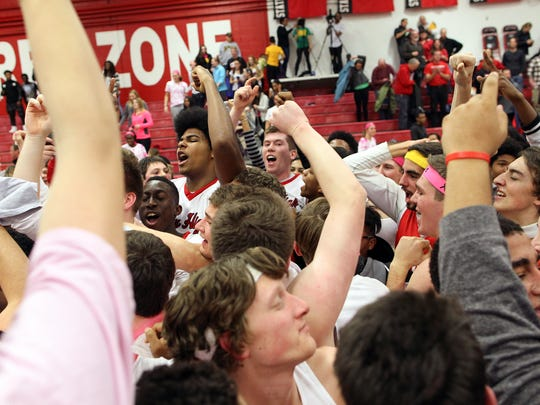 City High's Micah Martin (back left) celebrates with