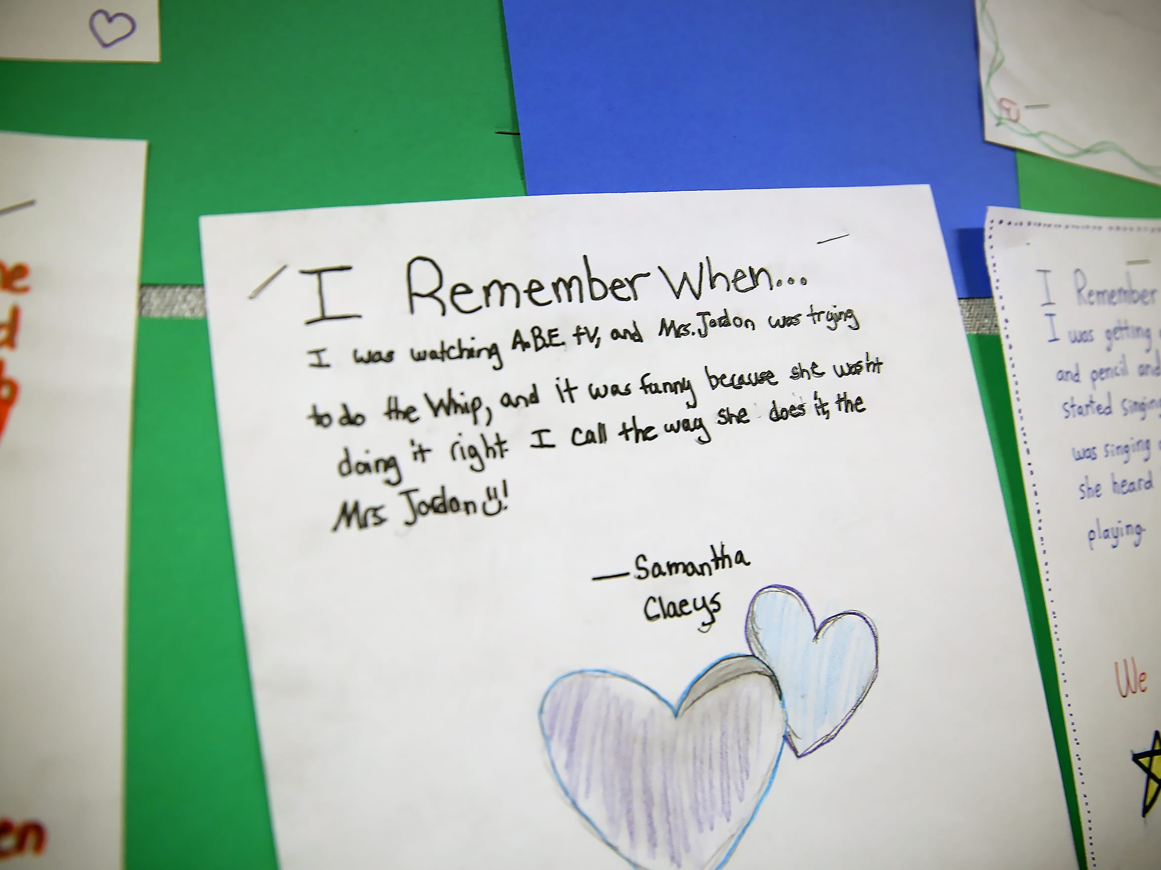 A wall of student writings at Amy Beverland Elementary remember their late principal, Susan Jordan. The longtime principal was killed in an accident at the school.