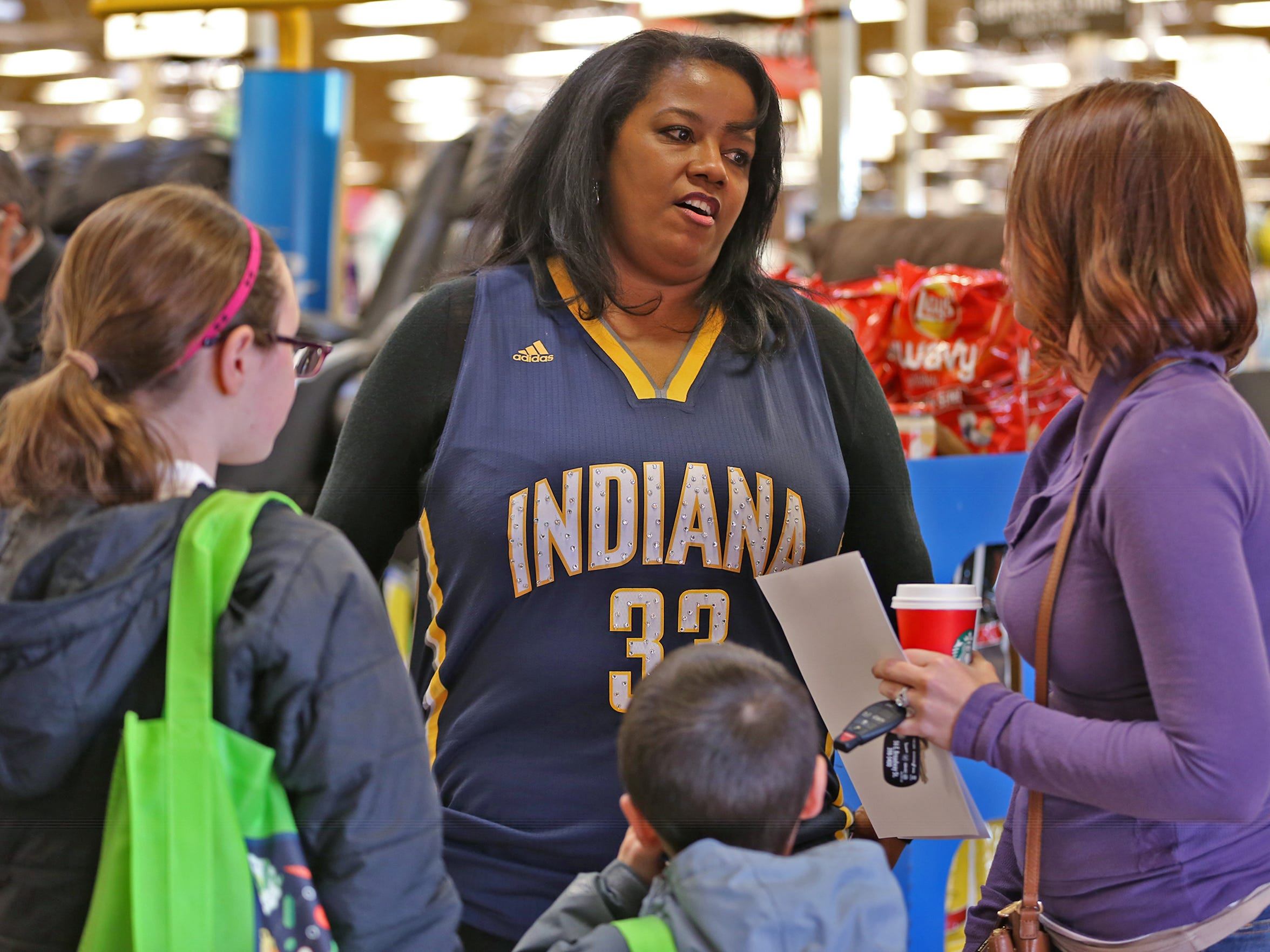 Mary Turner talks to fans during an autograph session with her son, Myles Turner at Kroger, Friday, January 29, 2016, promoting his WARM (We All Really Matter) program.