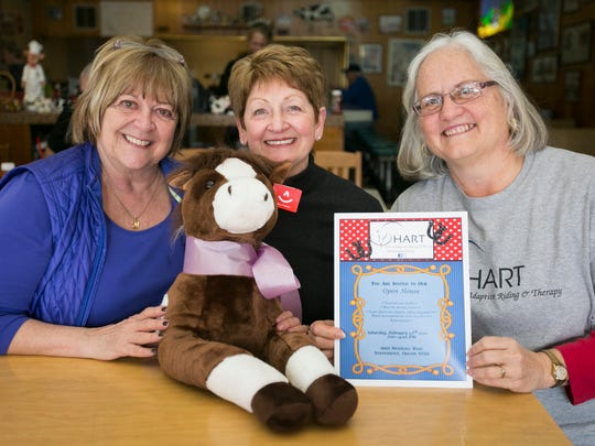 Gretchen Hoppe, from left, Myrna Gulick and Debbie Rambeck came to Holding Court to invite the community to a February 27 open house for HART (Horses Adaptive Riding & Therapy). The organization has a new facility in Independence.