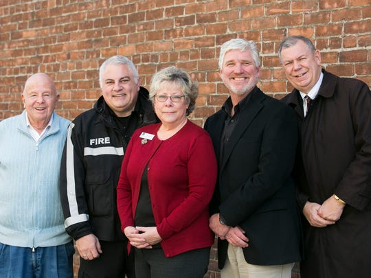 Gerry Frank, left, joins Salem Fire Chief Mike Niblock, Sue Moore, Alex Rhoten and Danny Bisgaard of the Salem Fire Foundation at Holding Court on Tuesday. Members of the foundation hope to solicit applications for automated external defibrillators from community members who may be interested in the device.