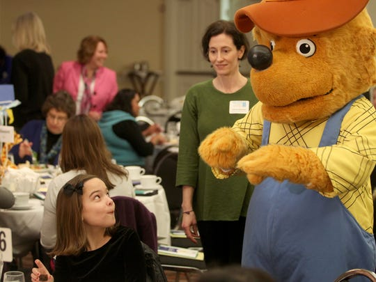 11 year-old Lucy Rood with Lemme Elementary gets a visit from The Berenstain Bears' Papa Q. Bear during the second annual One Book Two Book Festival held at the Iowa City Sheraton on Friday, January 11, 2012.