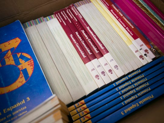 Boxes of Spanish language books are ready to be packed up at the old home of the Mid-Valley Literacy Center on Wednesday.