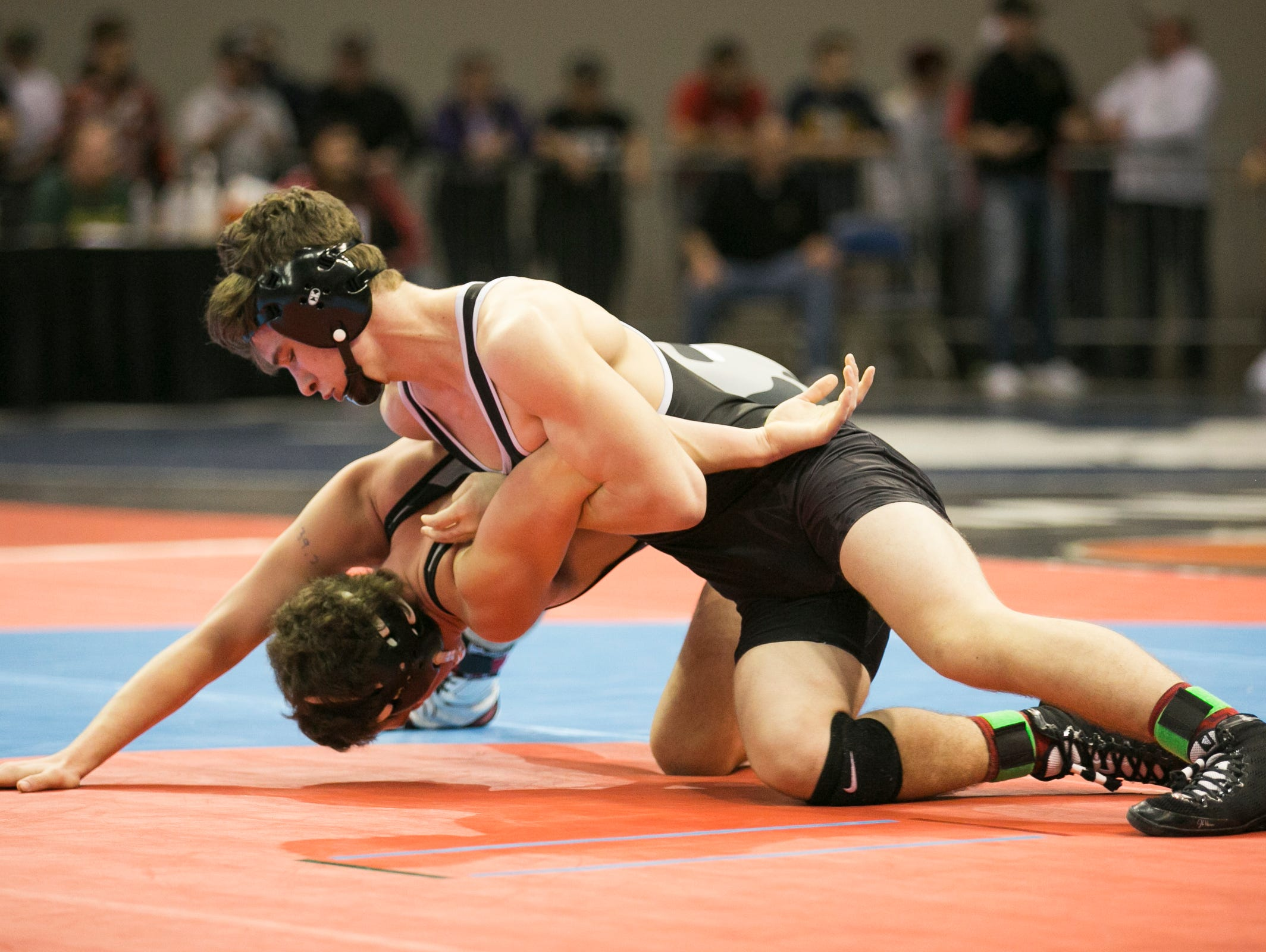 Dayton's Jared Henry holds onto Vale's McKay Bennett at the OSAA state wrestling tournament on Friday, Feb. 26, 2016, at Memorial Coliseum in Portland, Ore. Henry won the match by fall.