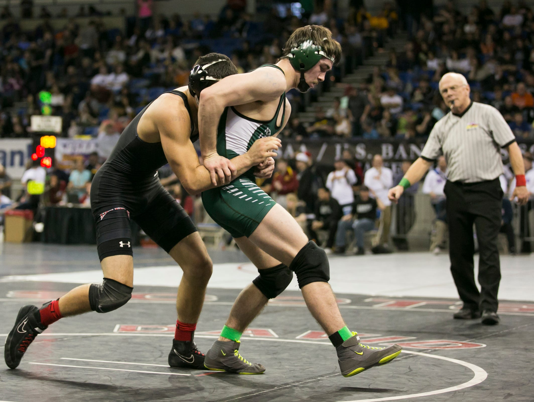 North Marion's Lane Stigall tries to break free of Tillamook's Tylor Garcia at the OSAA state wrestling tournament on Friday, Feb. 26, 2016, at Memorial Coliseum in Portland, Ore. Stigall won the match up.