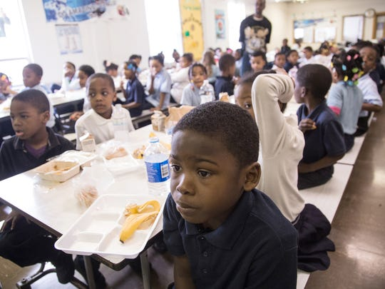 Northridge Academy first-grader Allen Moore watches a television show with other students during lunch on Thursday February 4, 2016 at the charter school.