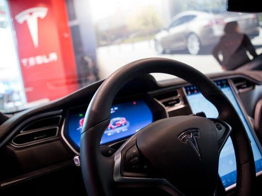 The Tesla Model S P90D sits at the Tesla Motors Showroom in Scottsdale Fashion Square.