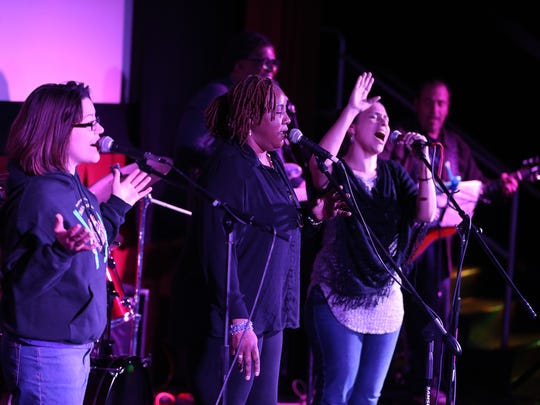 Members of the Oasis Church worship band perform, Sunday, February 28, 2016, during a church service in a theater at Regal Cinemas in South Plainfield.