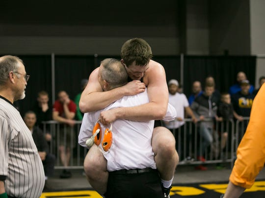 Scio's Justin Parazoo celebrates with his coach after defeating Pleasant Hill's Noah Casarez at the OSAA state wrestling tournament on Saturday, Feb. 27, 2016, at Memorial Coliseum in Portland, Ore.