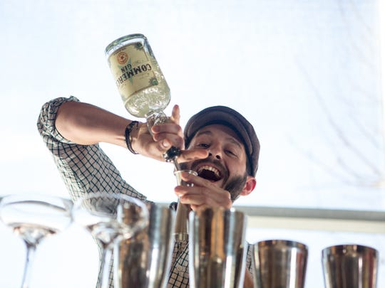 Michael Liberatore from Citizen Public House mixes a Na-Na-Na Boo Boo drink during the first heat of the Devour Bartending Competition at DeSoto Central Market in Phoenix on Feb. 28, 2016.