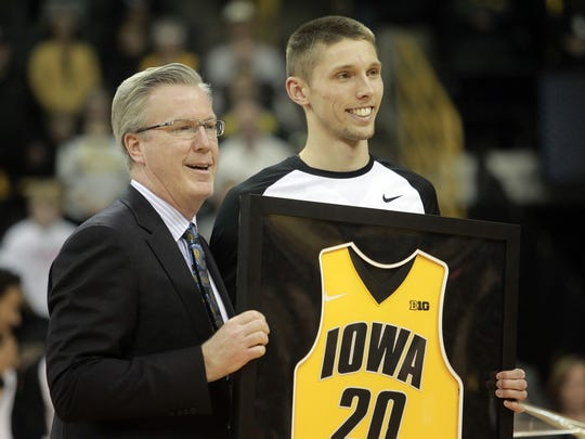 Iowa's newest recruit Jack Nunge could offer coach Fran McCaffery, left, a lot of what Jarrod Uthoff, right, brought to the court for the Hawkeyes.