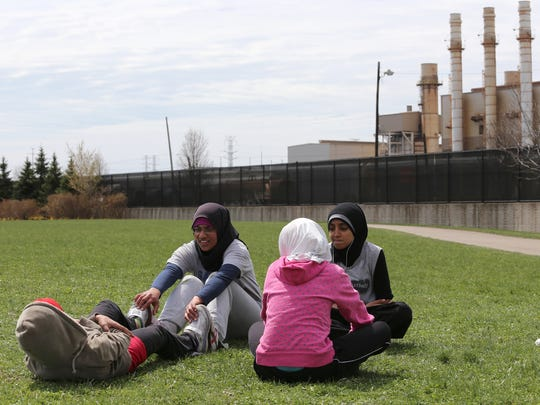 Members from the track team from Salina Intermediate workout at the school's track field where you can see the Industrial zone in the background on Thursday, April 23, 2014.