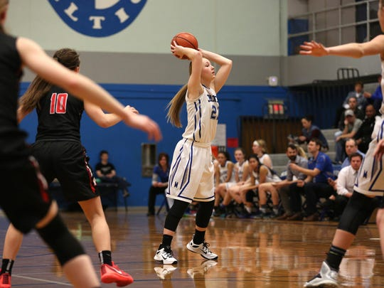 McNary senior Madi Hingston (21) passes to a teammate in a game against McMinnville on Friday, Jan. 22, 2016 at McNary High School in Keizer.