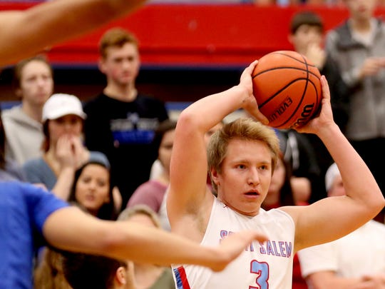 South Salem's Gabe Matthews (3) looks to pass the ball in the McNary vs. South Salem boy's basketball game at South Salem High School on Tuesday, Feb. 2, 2016. South Salem won the game 53-52.