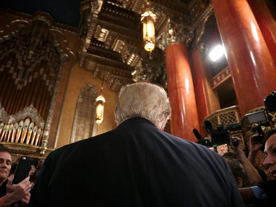 Donald Trump talks to the media after the Fox News