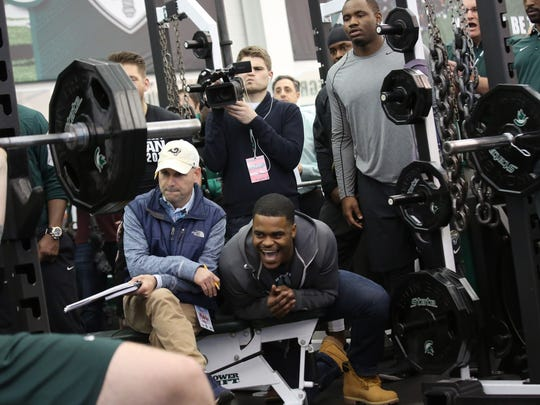 Michigan State players are cheered on as they lift weights on Pro Day at the Duffy Daugherty Football Building in East Lansing. on Wednesday, March 16, 2016.