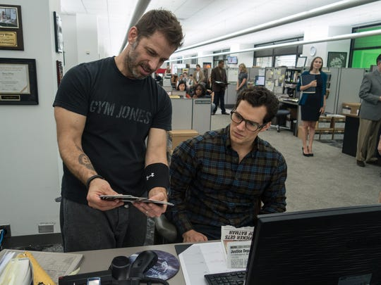 Director Zack Snyder, left, and Henry Cavill on the