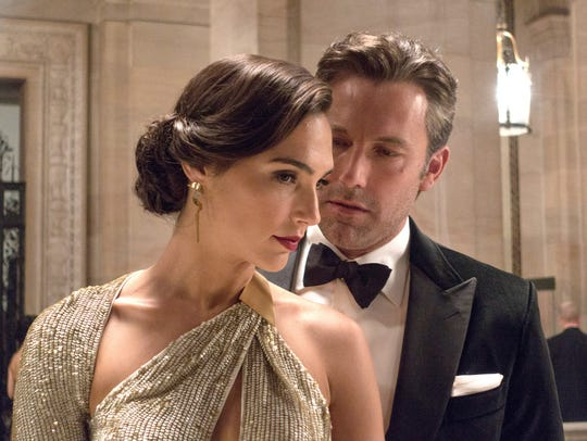 Gal Gadot, left, as Diana Prince and Ben Affleck as