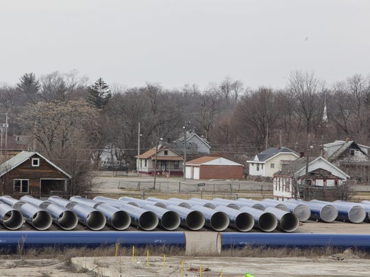 Sections of pipeline marked with KWA are seen in a lot along Stewart Ave in Flint on Friday, Feb. 5, 2016.