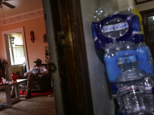 """Cases of bottled water sit in the hallway outside Whiteside's apartment. """"I'm not going to give up,"""" he says. """"I just have to keep trying."""""""