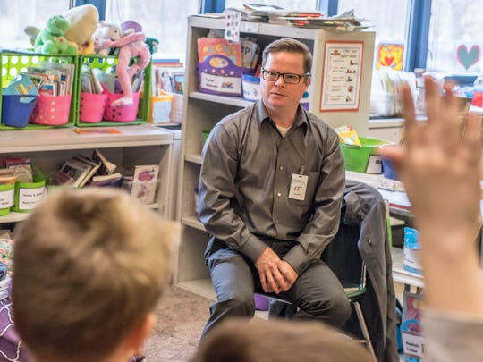 Downtown Development Director John Hart asks business questions to North Pennfield Elementary second-grade students on Wednesday.