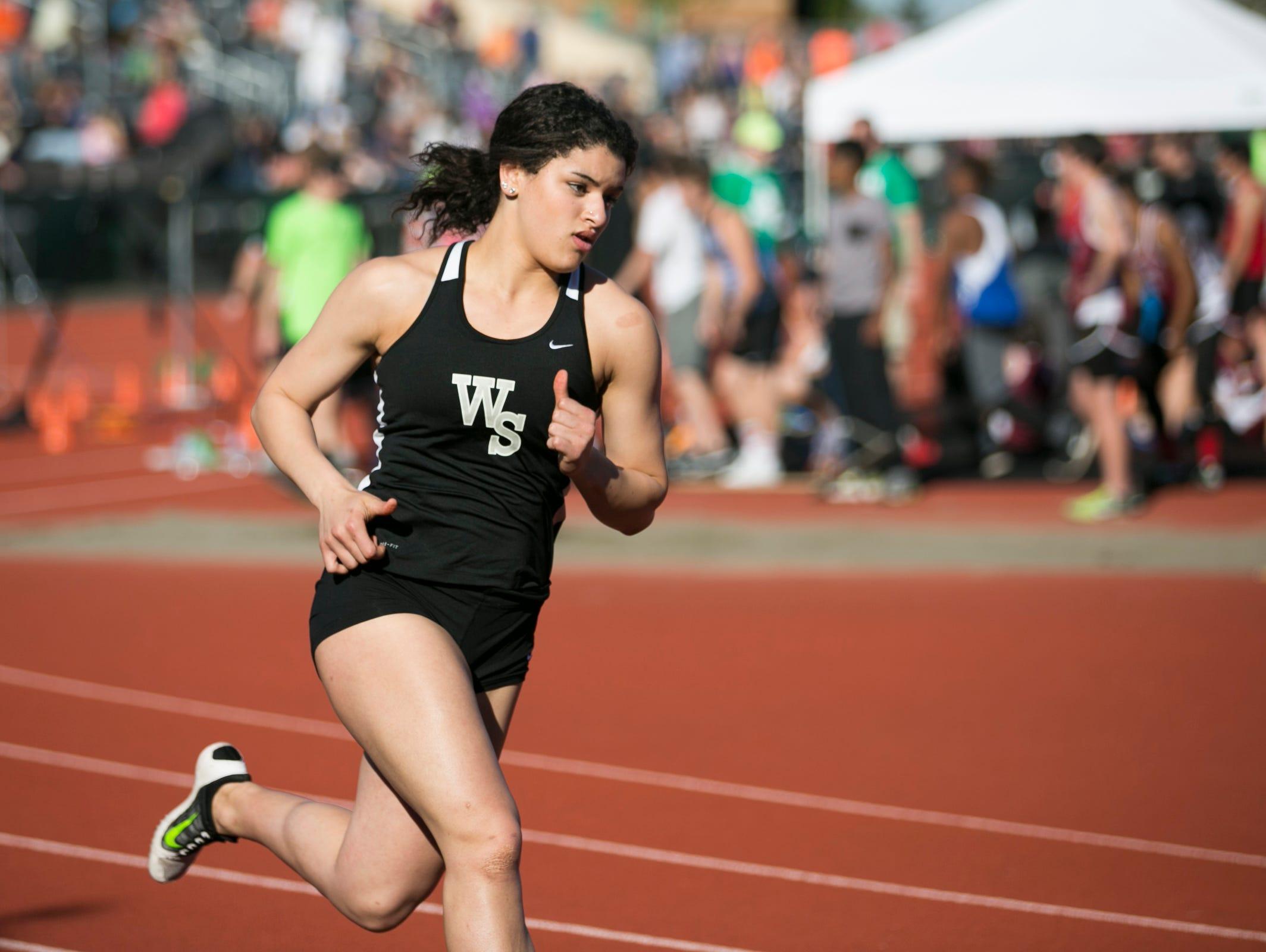 West Salem's Cari McCrae runs the girls 400 meter at the Titan Track Classic at West Salem High School on Friday, April 1, 2016.