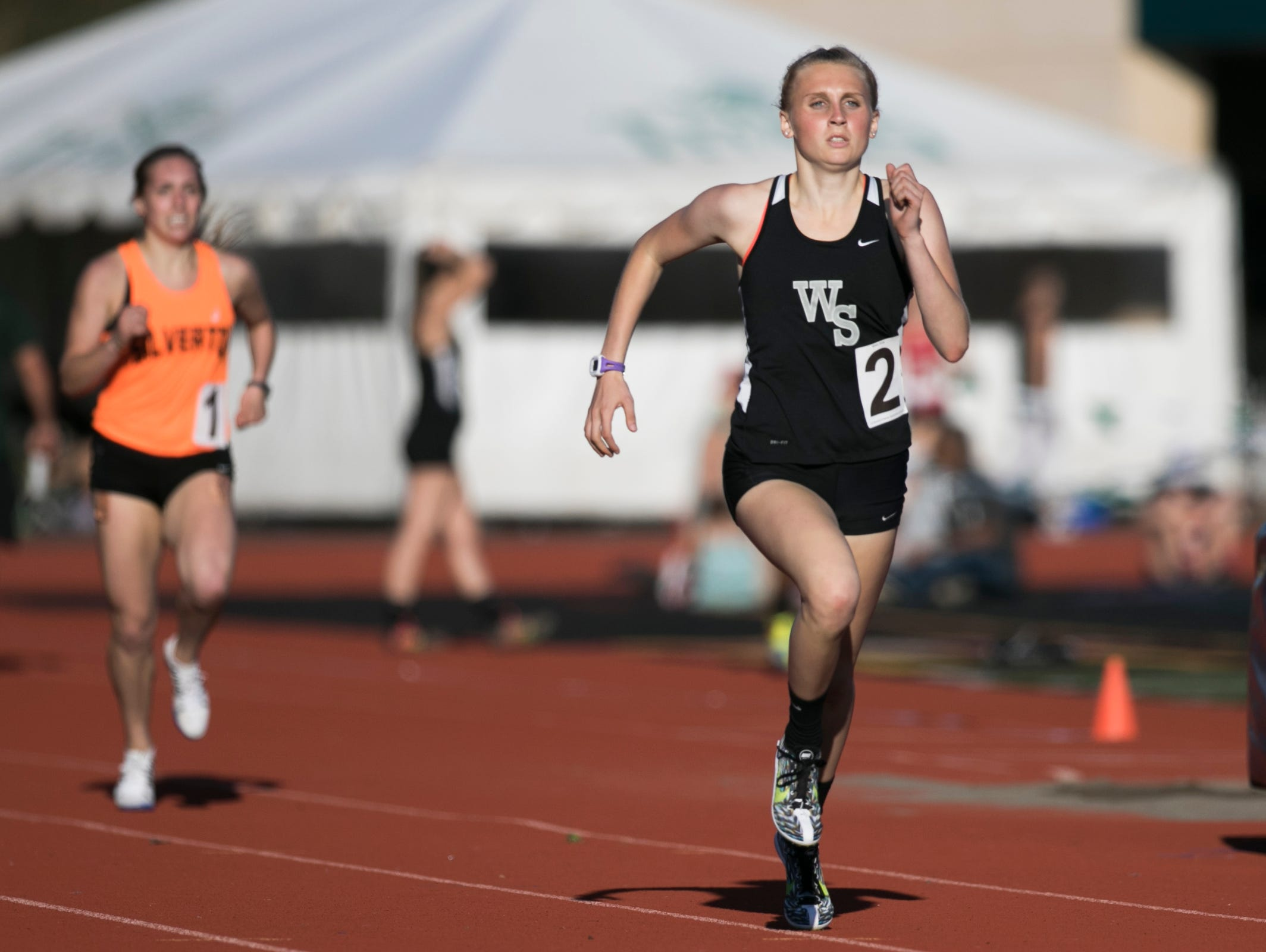 West Salem's Brook Chuhlantsheff pulls away from competitors to win the girls 800 meter race at the Titan Track Classic at West Salem High School on Friday, April 1, 2016.