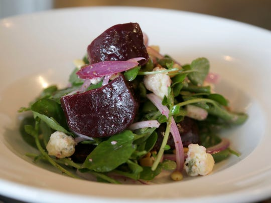 Pickled beets salad with gorgonzola, red onion, pine nuts, watercress and olives.  The Central Kitchen + Bar is in the First National Bank Building in downtown Detroit.