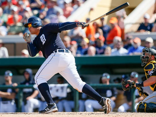 Tigers first baseman Miguel Cabrera singles on a line drive during an exhibition game at Joker Marchant Stadium on March 1.