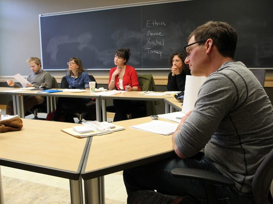John D'Agata listens to students discuss works in his course at the Adler Journalism Building on Monday, March 21, 2016.