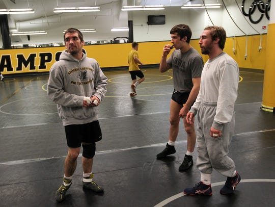 Former Hawkeyes Brent Metcalf, left, and Daniel Dennis,