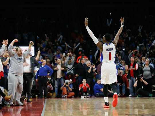 Pistons guard Reggie Jackson lifts his hands up in the air bringing fans to their feet after defeating the Thunder, 88-82, at the Palace on March 29.