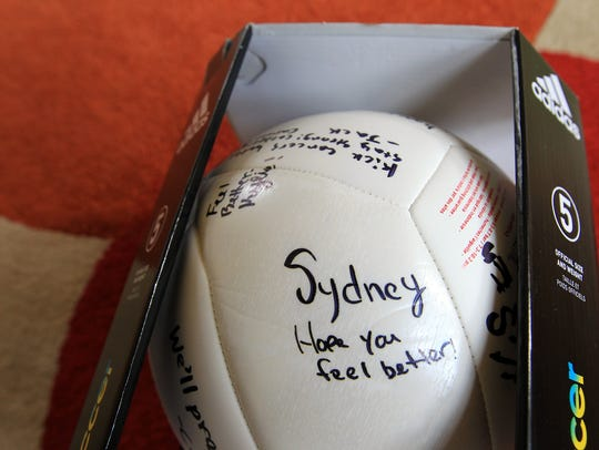 A signed soccer ball for Calder Wills is seen in his