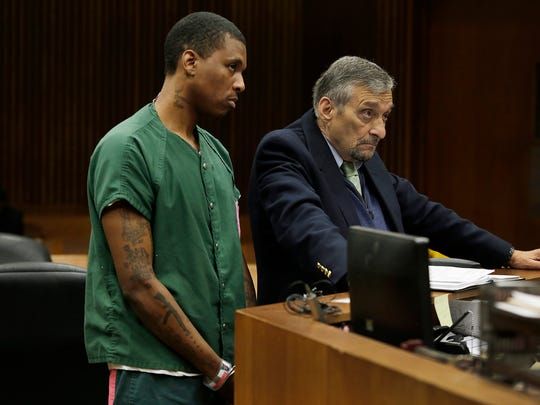 Jonathan Burks, left, stands with his attorney James Howarth Monday April 11, 2016 in the Wayne County Circuit courtroom of Timothy Kenny at the Frank Murphy Hall of Justice.