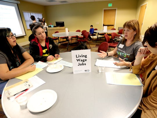 Sandra Hernandez, from left, Arcelia Lomeli, Lynn Irvin and Marla McColly, all of Salem, discuss the causes of and potential solutions for the lack of widespread opportunities for living wage jobs during a breakout session in the Listen to Her town hall at Chemeketa Community College in Salem on Tuesday, April 12, 2016. The event, hosted by the Women's Foundation of Oregon, is part of a tour of town halls to listen to the needs and stories of women and girls across the state.
