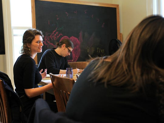 Susannah Davies critiques a piece with classmates in Ethan Canin's  fiction writing workshop at the Dey House on Tuesday, April 5, 2016.