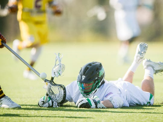York College's Conrad Ordakowski (40) dives for a loose ball against Salisbury in a Capital Athletic Conference men's lacrosse game at York College on Wednesday. The Spartans lost 17-5.