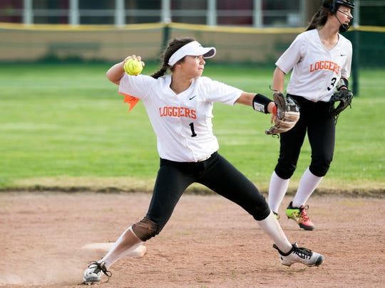 Scio's Ashton Phillips (1) throws to first in a game