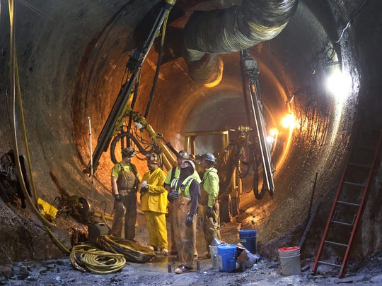 Workers work in the newest tunnel, the Shea-Kiewit tunnel, in the DigIndy Tunnel System, Thursday, April 21, 2016, the .  A completion plan was announced at the site to complete the remaining 18 miles of tunnel.  The system is a 28-mile network of tunnels 250 feet underneath Indy designed to prevent sewage overflows from reaching area waterways during moderate rain events.