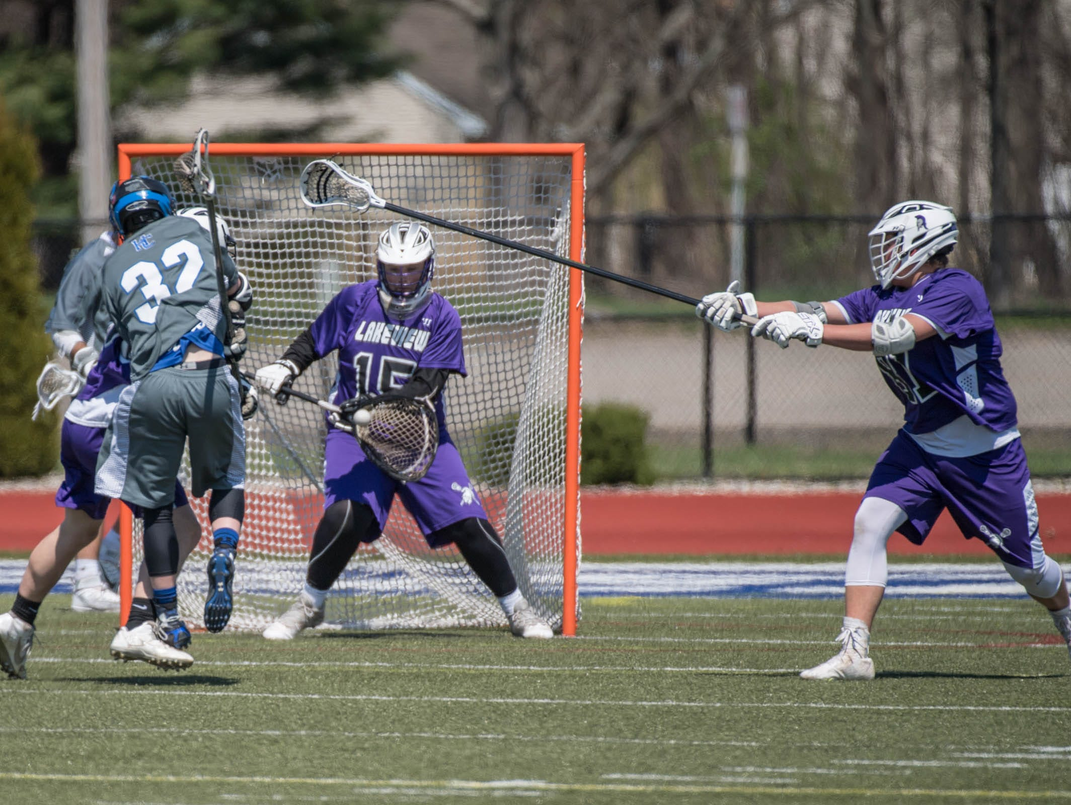 Lakeview's Jace Canfield (15) stops a score against Harper Creek in the All City Lacrosse Tournament on Saturday.