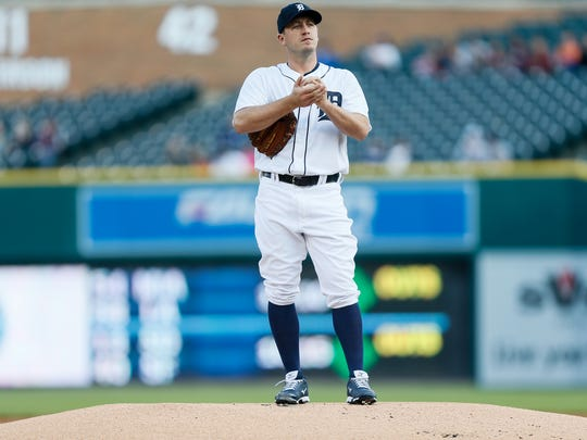 Tigers pitcher Jordan Zimmermann rubs up the ball during the Tigers' 7-3 win over the Athletics Monday at Comerica Park.