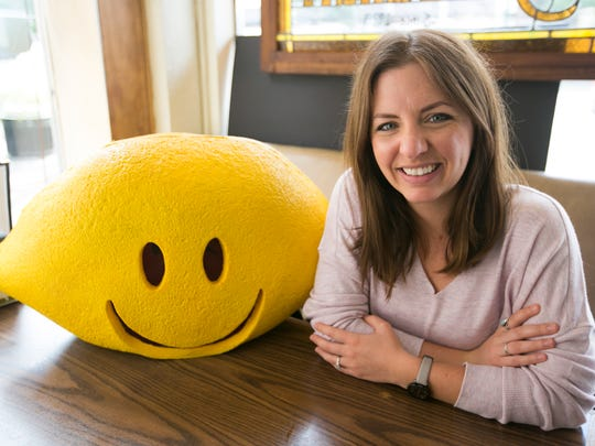 Joce Johnson and the lemon head remind you Lemonade Day is Sunday, May 1.