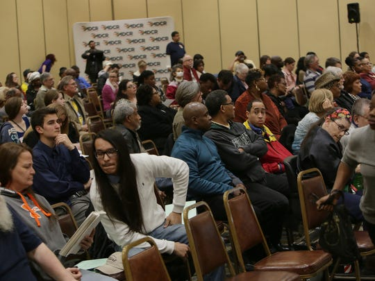 A crowd gathered listens as Flint residents speak during the Michigan Civil Rights Commission public hearing on Thursday, April 28, 2016, at the Riverfront Banquet Center in downtown Flint.